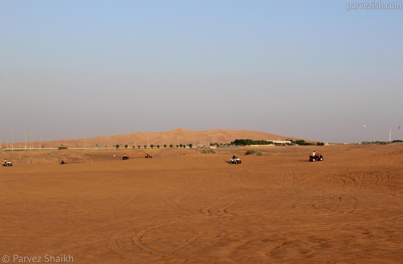 Driving Quad Bike At Dubai Desert