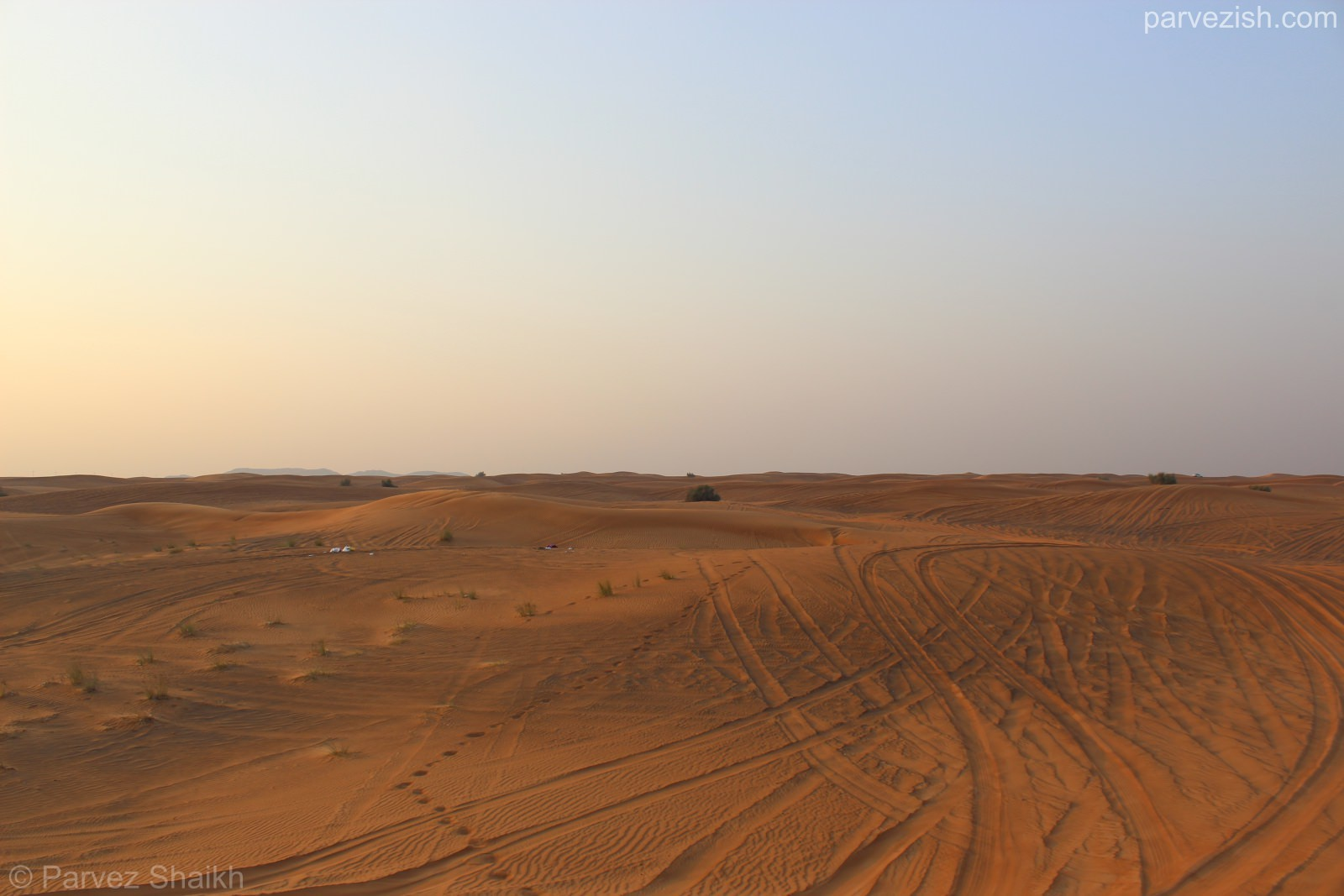 Cars And Humans Leaving Their Marks in the Dubai Desert