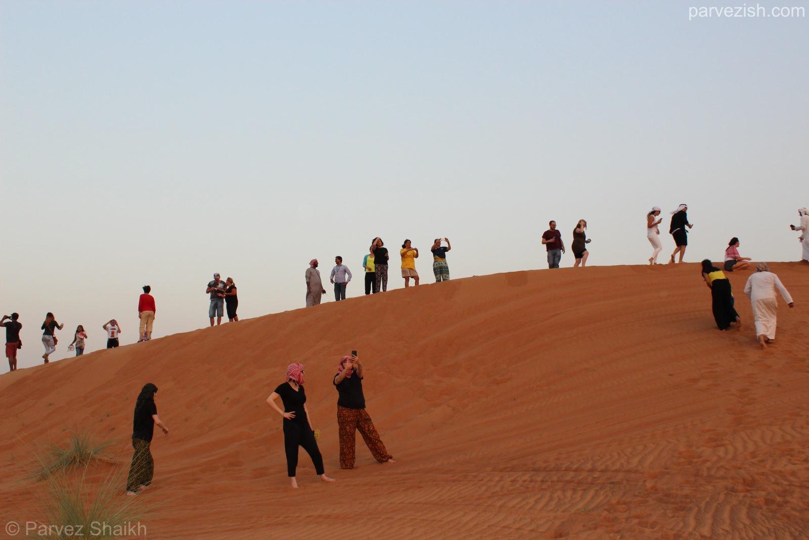 Visitors Taking Photos of Sunset from Dubai Desert