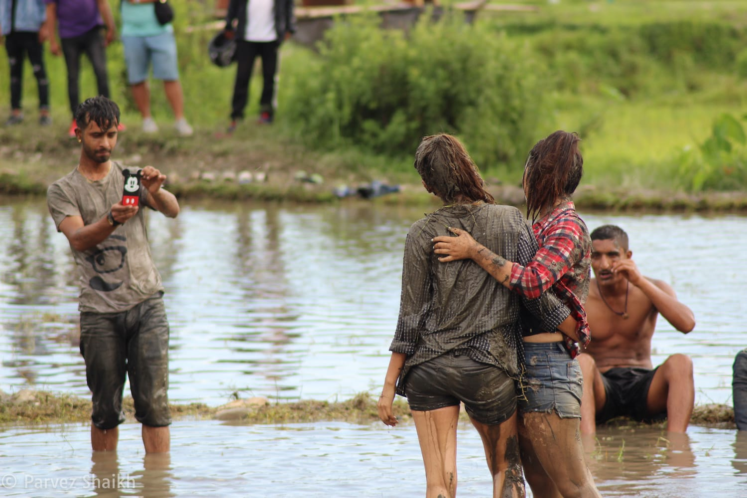 Visitors Having Fun in Mud at the Rice Planting Festival in Nepal