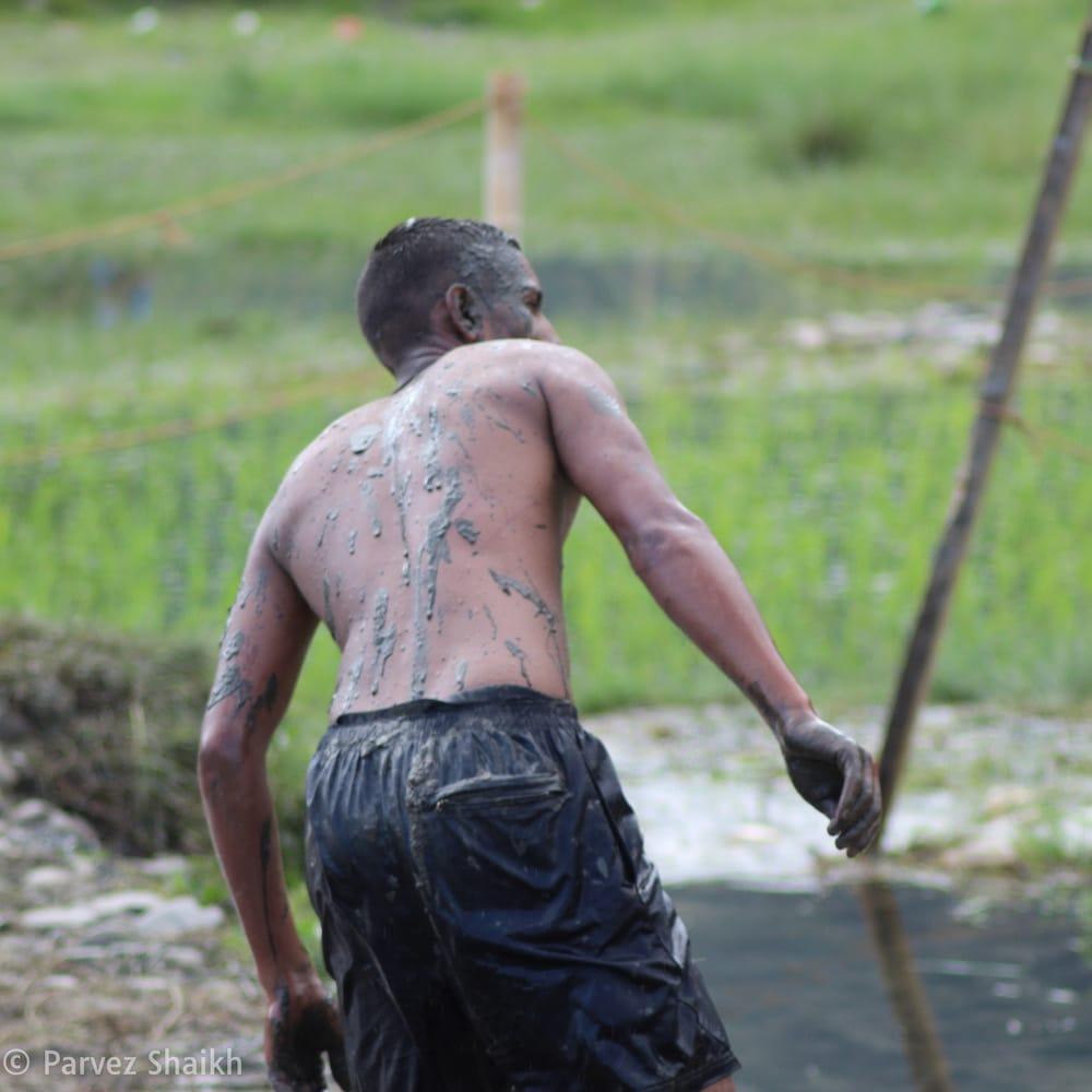 A Nepali Guy Throwing Mud at Girls