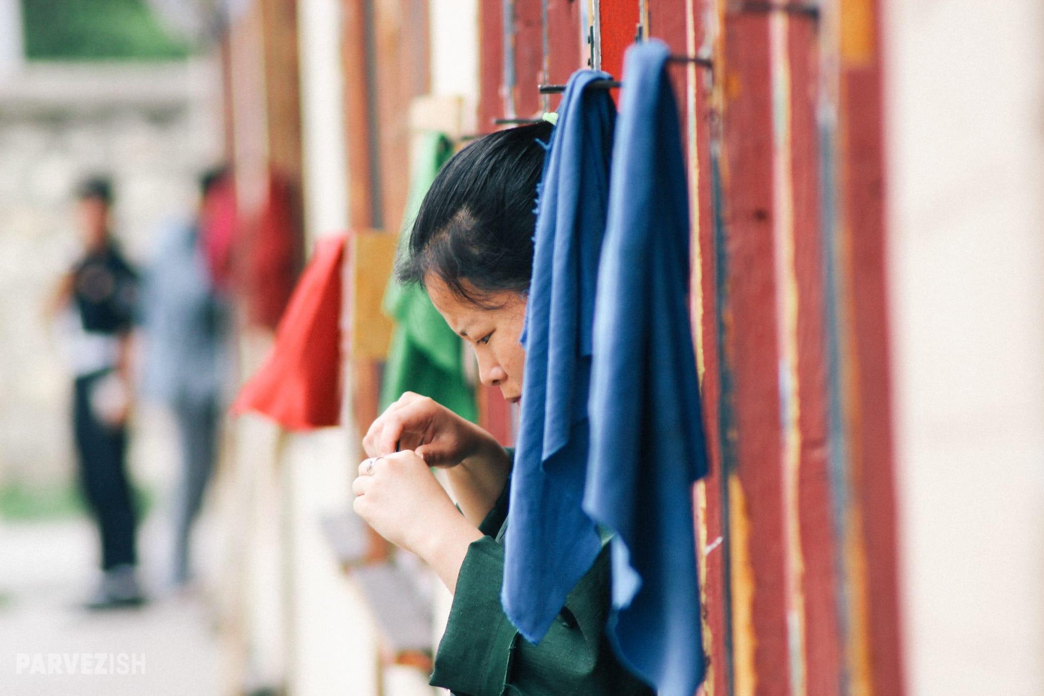 A Girl Clipping Nails in Paro Bhutan