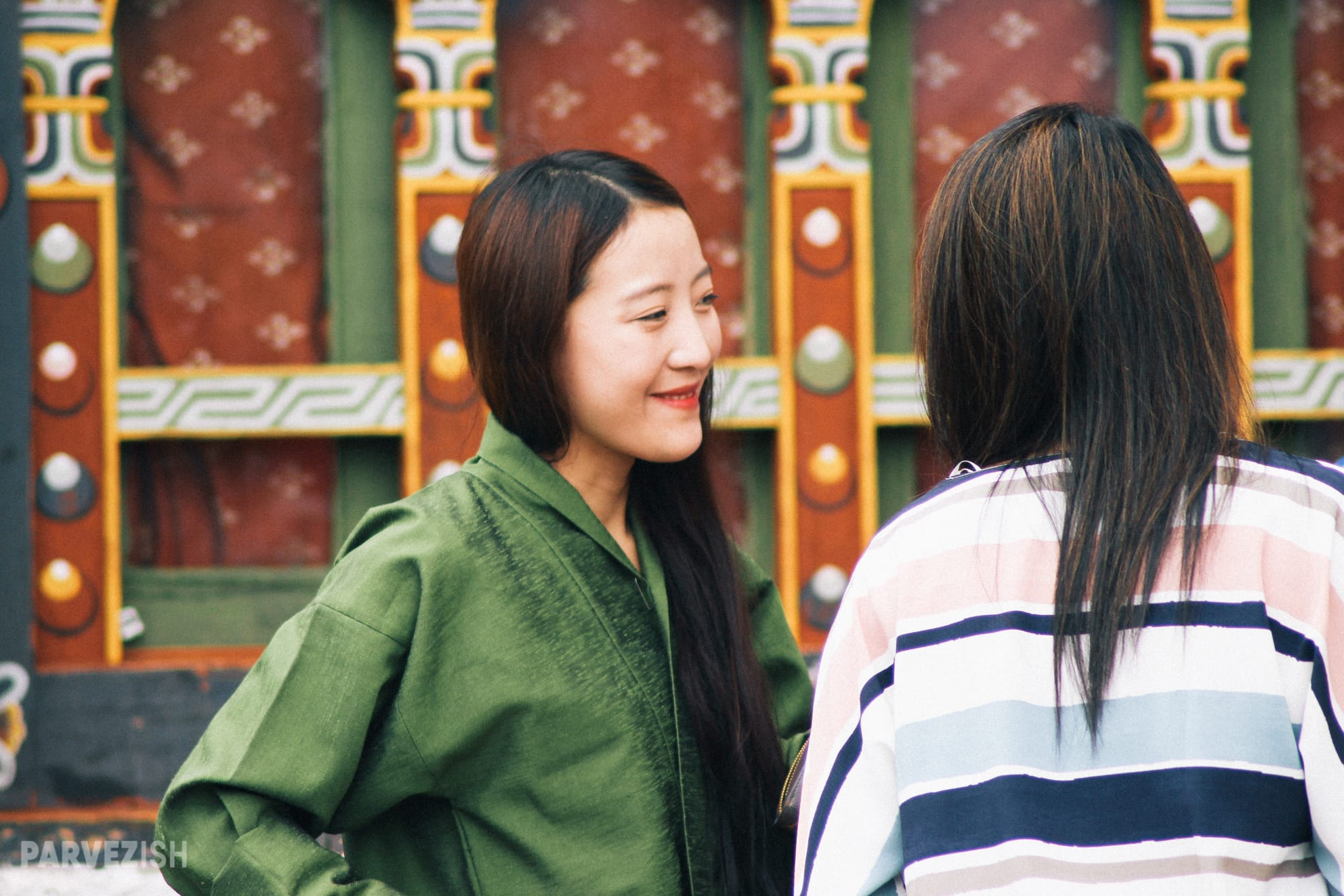 A Bhutanese Girl Engaging in Conversation with Tourists