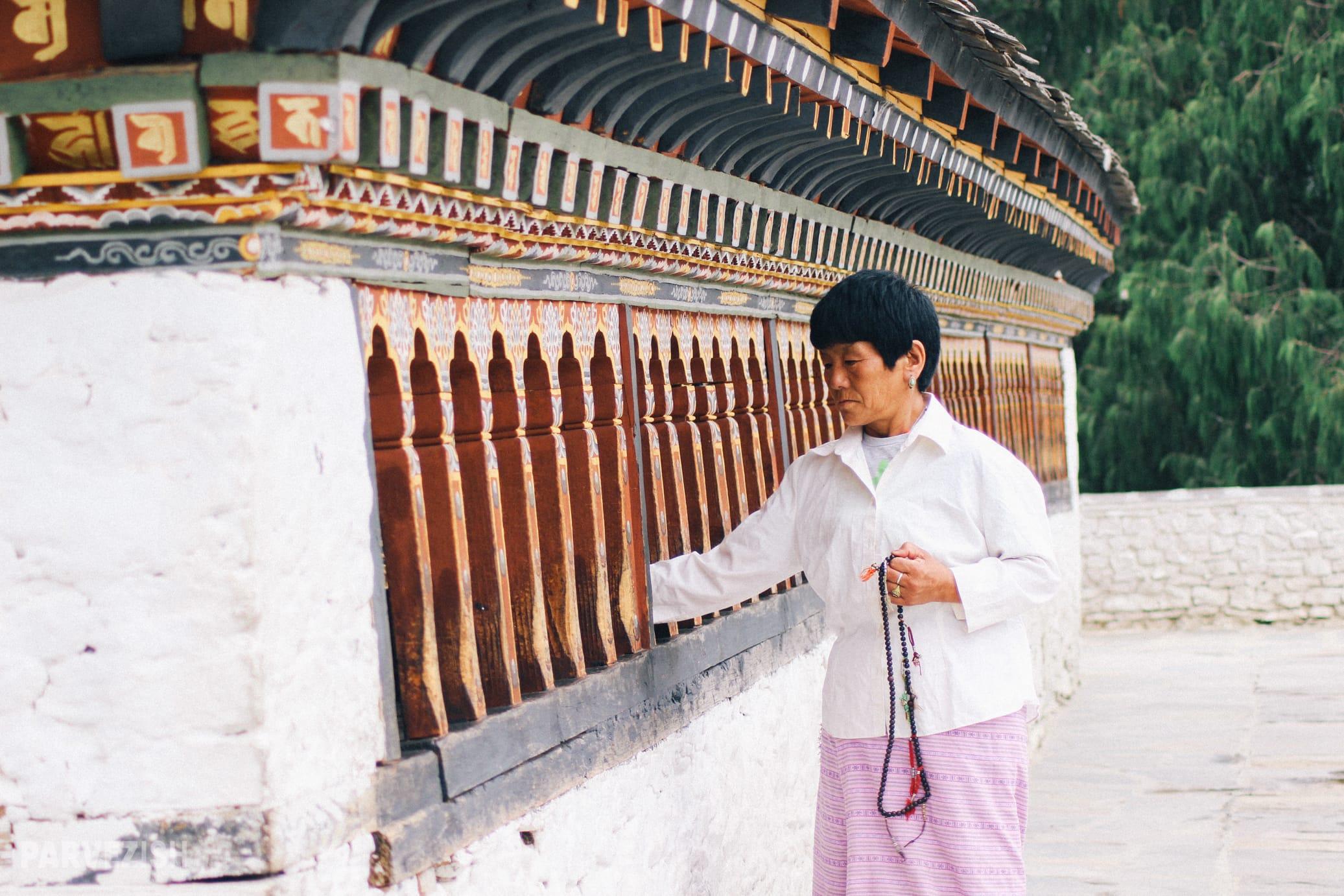 An Elderly Woman Praying at a Temple in Bhutan