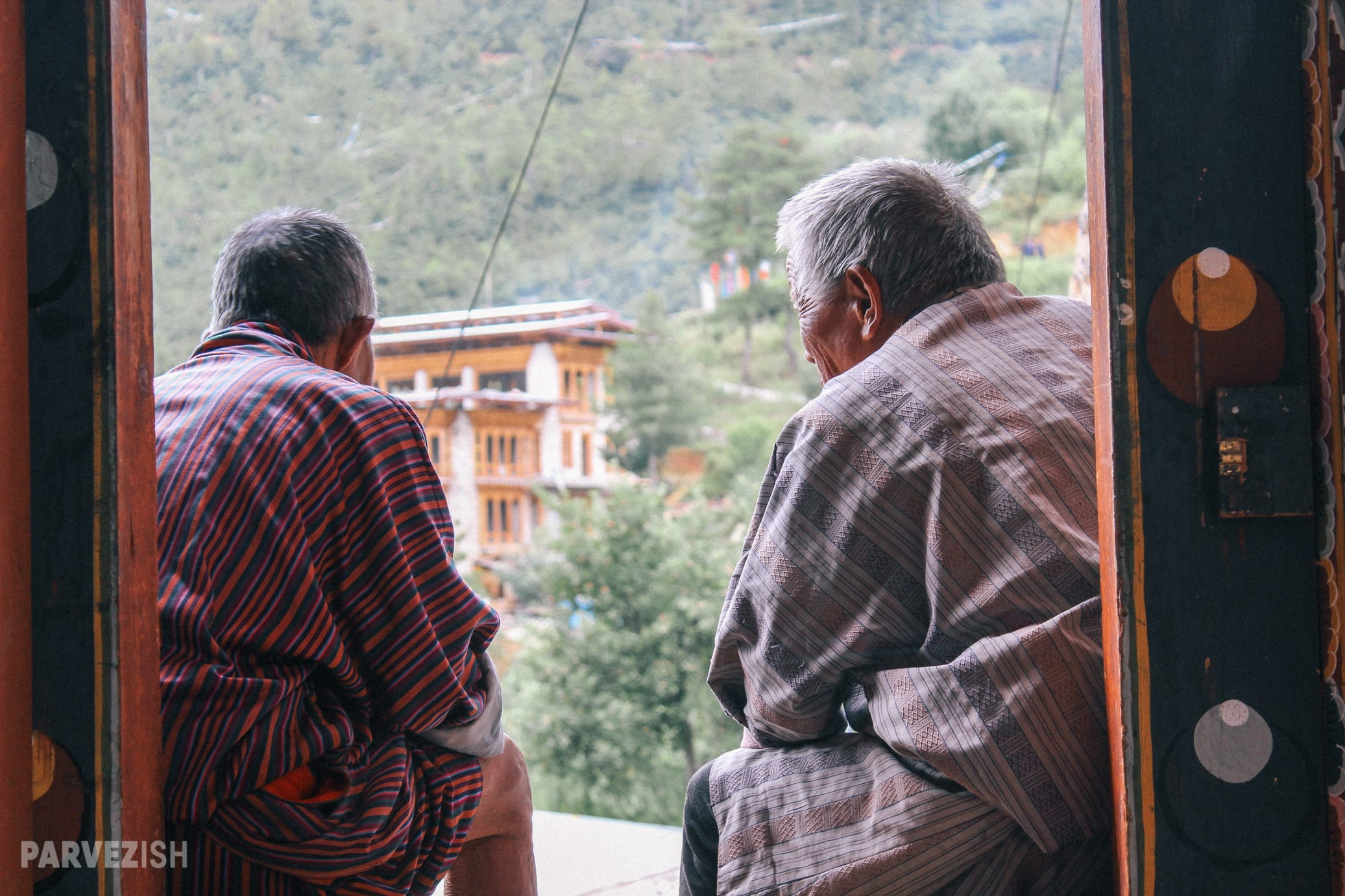 Two Men Engaged in a Conversation in Bhutan