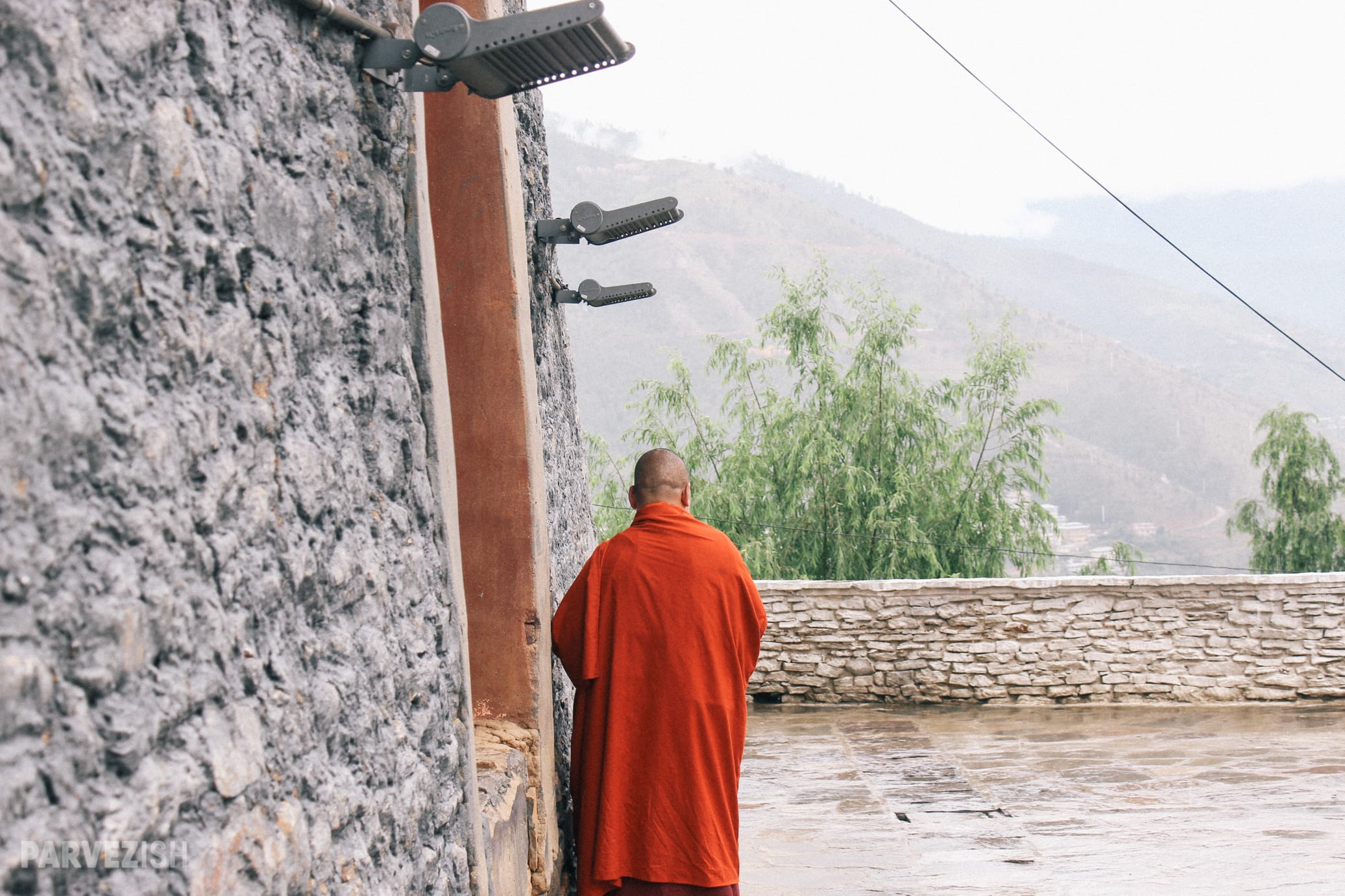 A Buddhist Monk By a Wall in Bhutan
