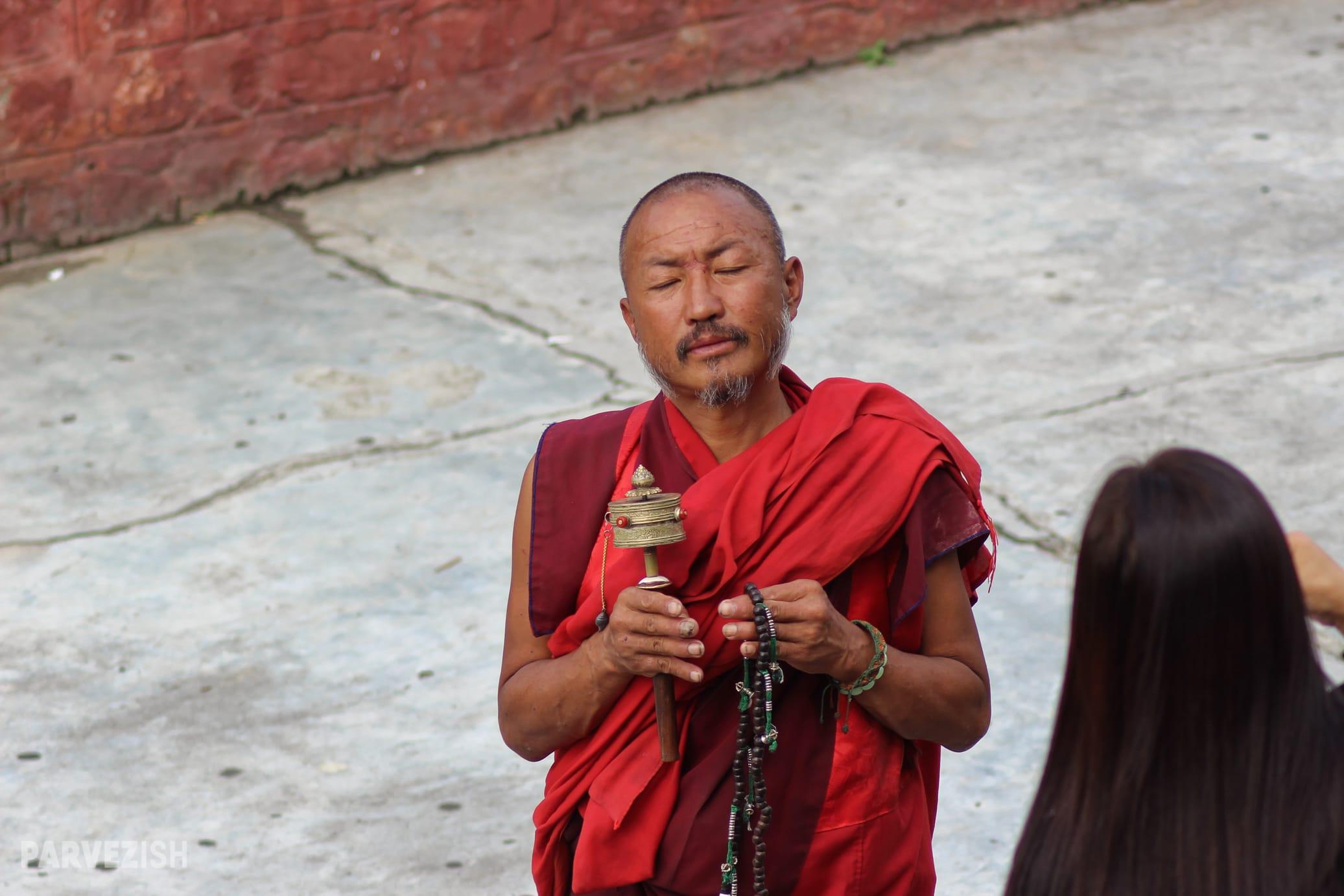 A Buddhist Monk Seeking Alms in Thimpu Bhutan