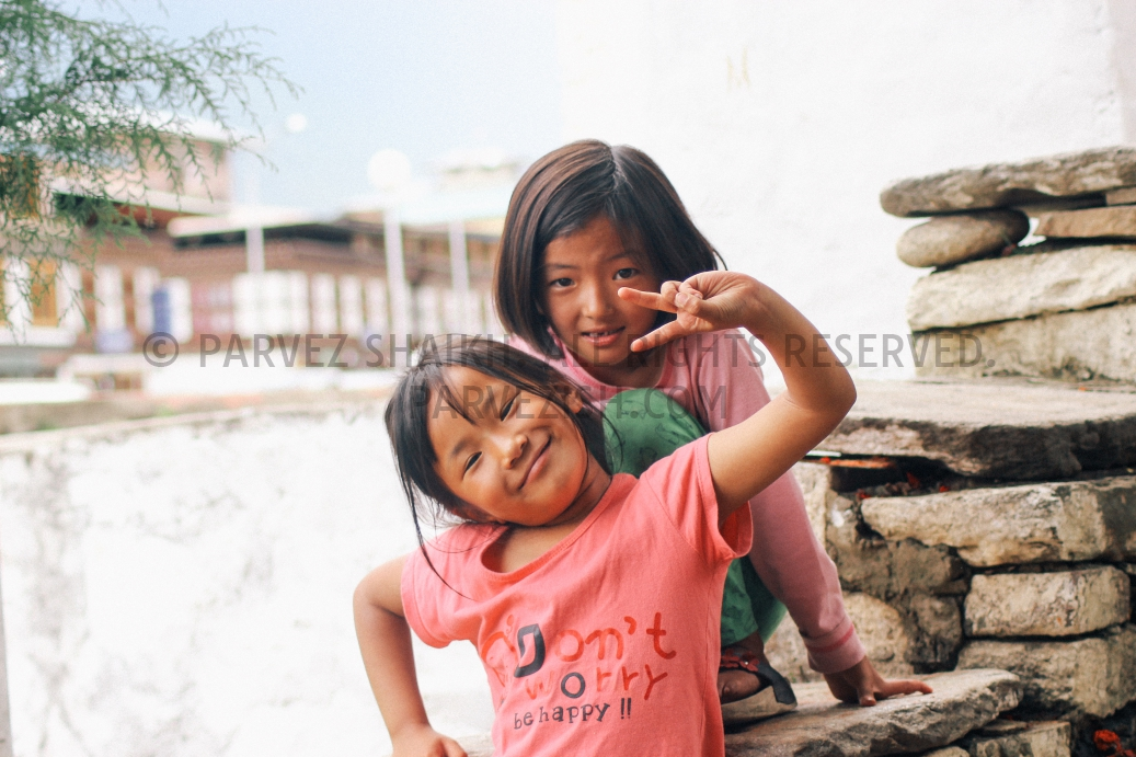 Bhutanese children are posing for a photograph in Paro