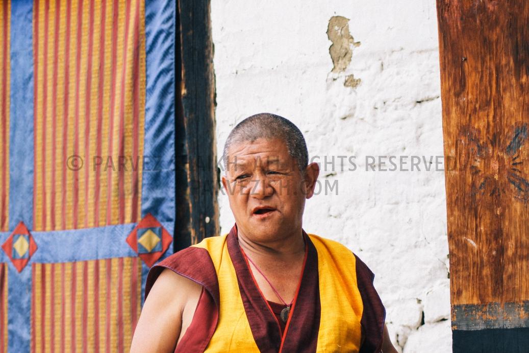 A Buddhist monk outside a temple in Paro, Bhutan