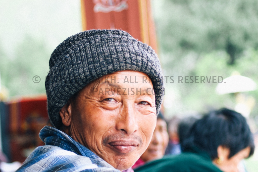 A Bhutanese man is photographed as he looks at the camera