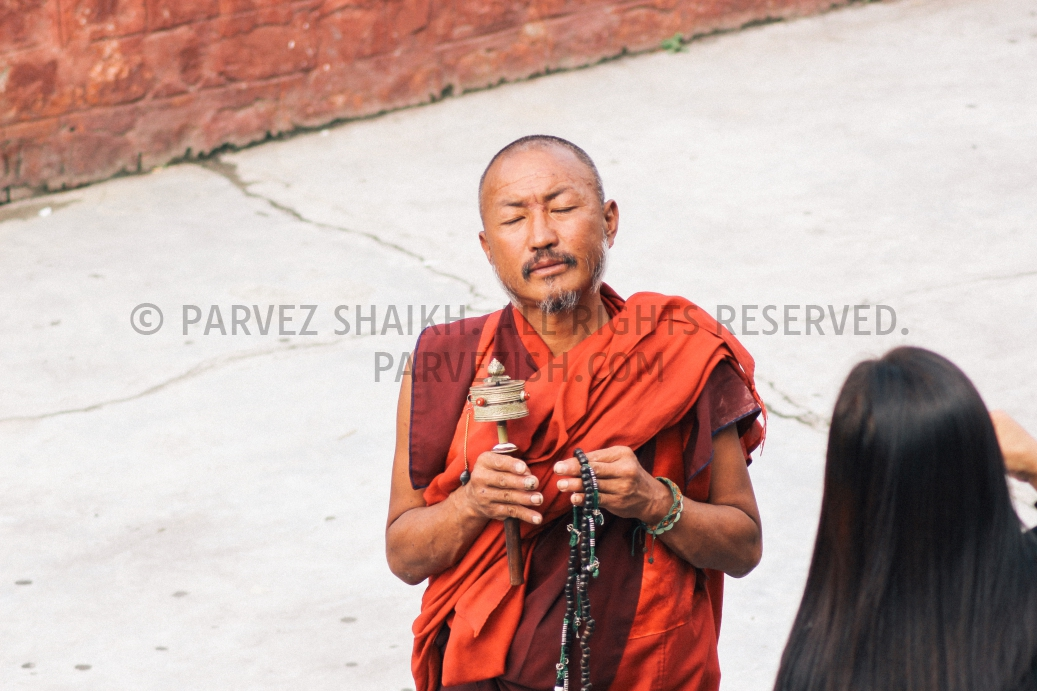 A Buddhist monk collecting alms in Thimphu town center