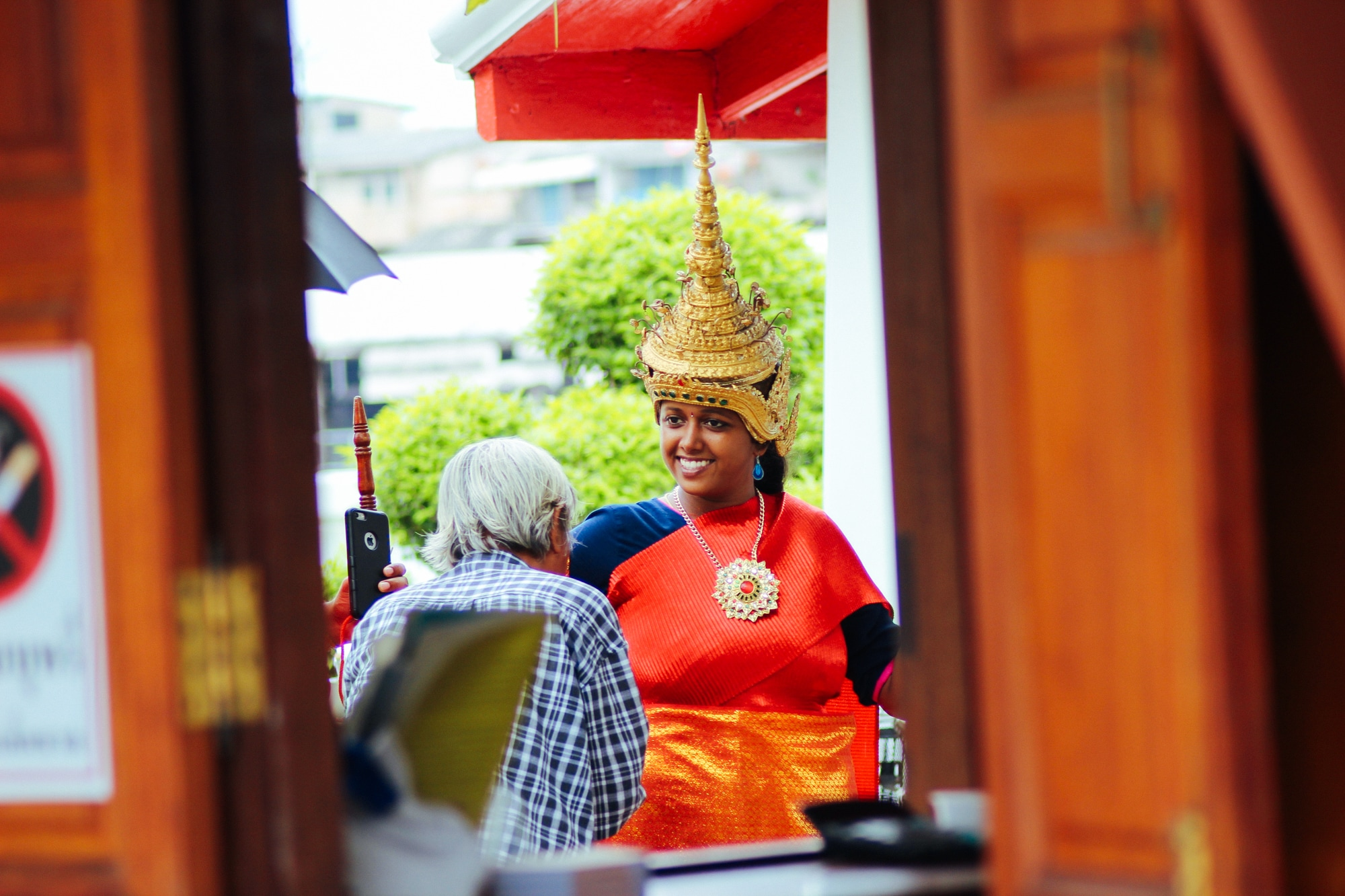 A tourist dressed up in Thai attire