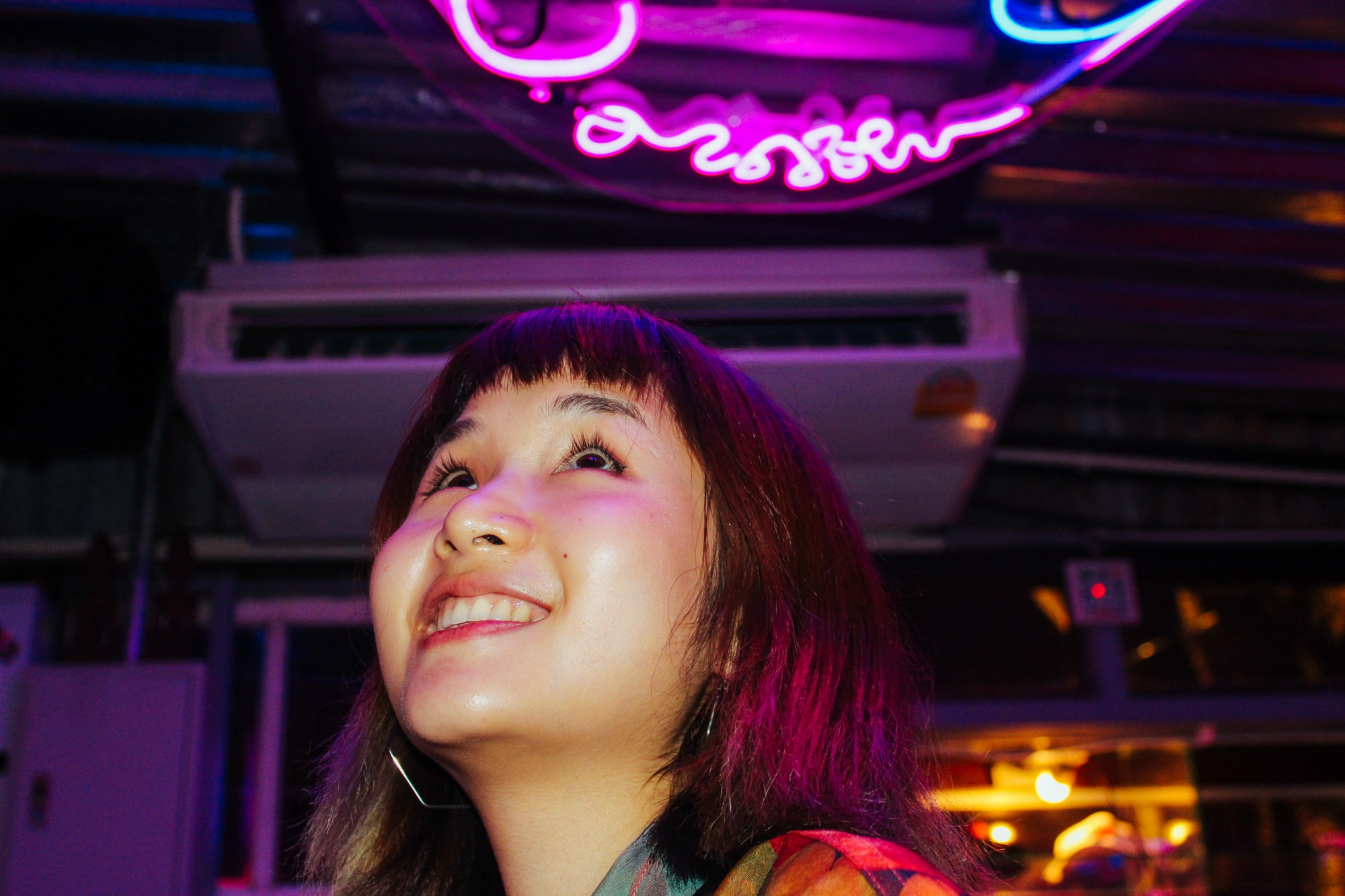 A girl poses for picture at a bar