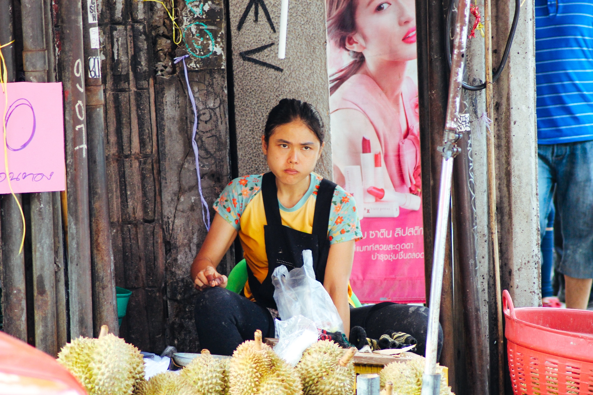 A woman selling durian