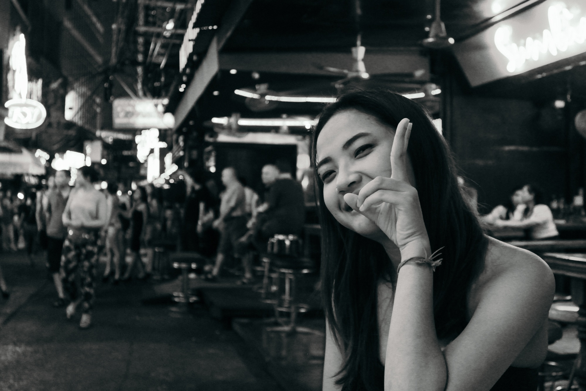 A girl poses for a picture at one of the night markets