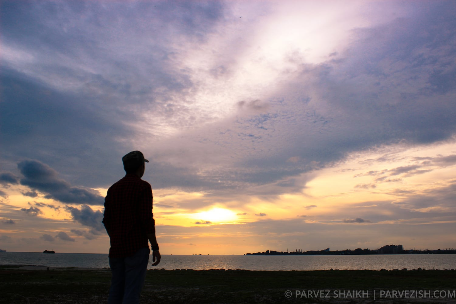 Observing the Sunset from Sand Dunes of Malacca