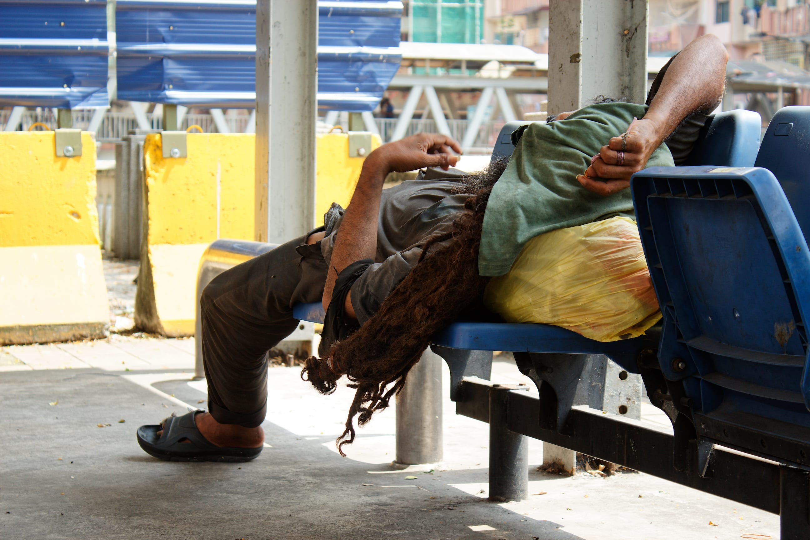 A Homeless Man Resting in Kuala Lumpur