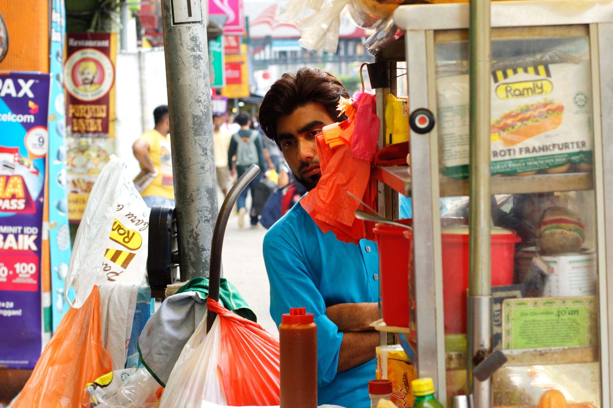 A Man at a Street Food Stall in Kuala Lumpur