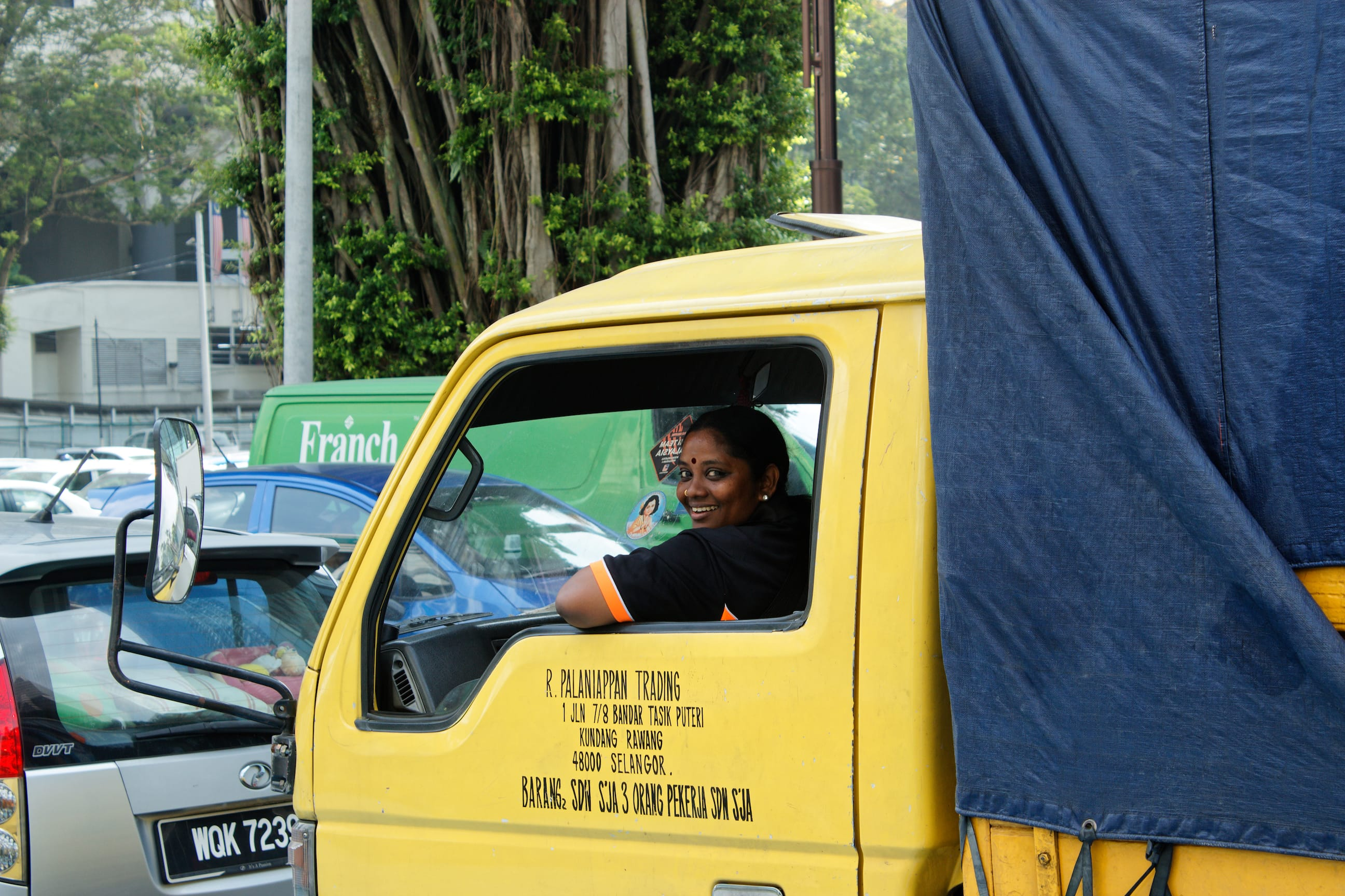A Woman Smiles from a Vehicle