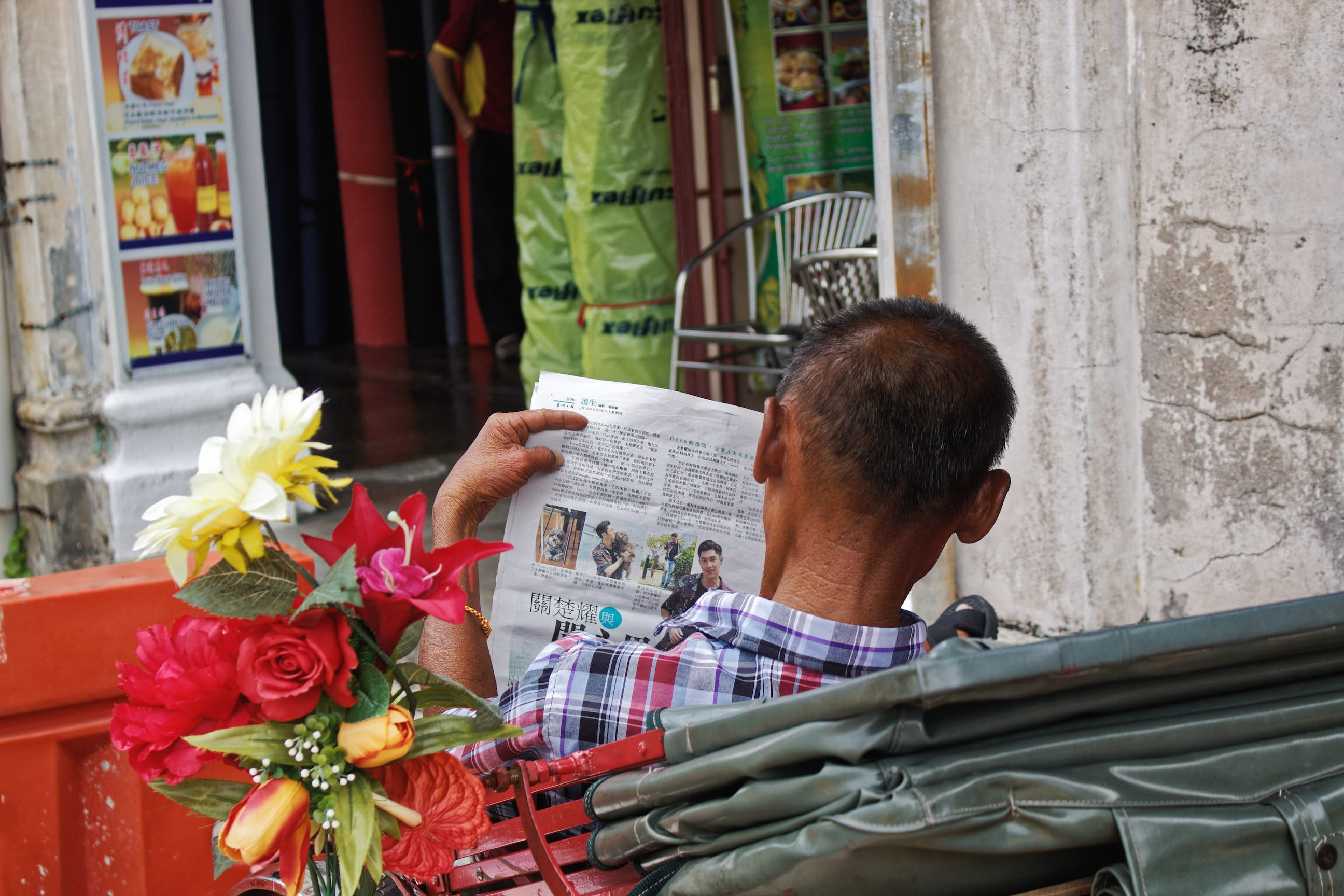 A Man Reading Newspaper