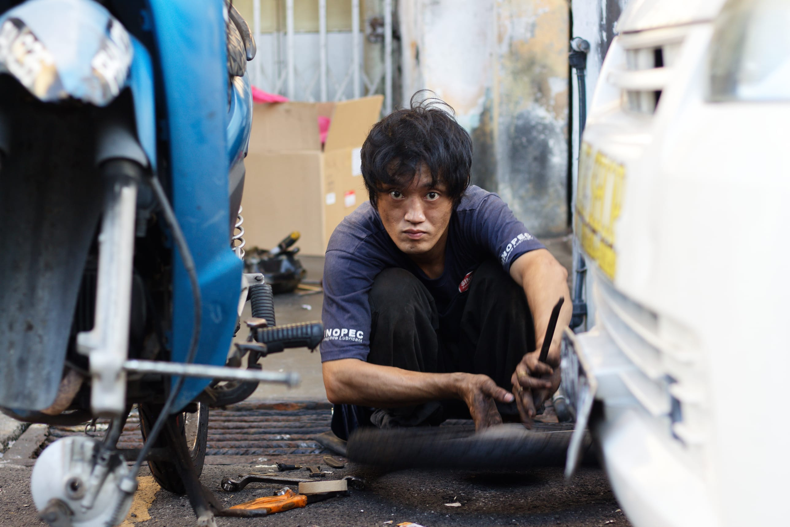 A Mechanic in a street of George Town Malaysia