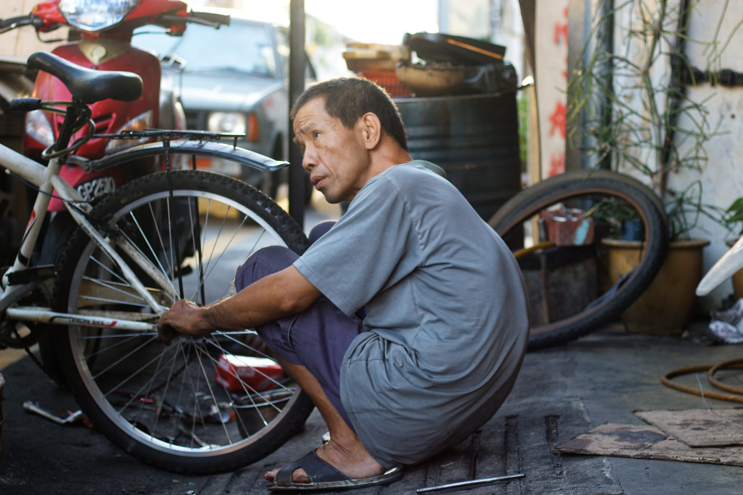 A Bicycle Mechanic in Streets of George Town