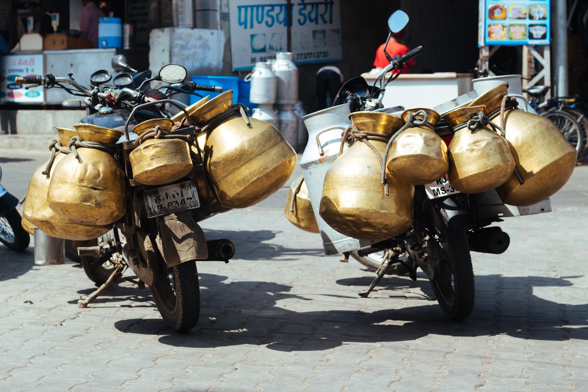Metal milk pots on motorcycles