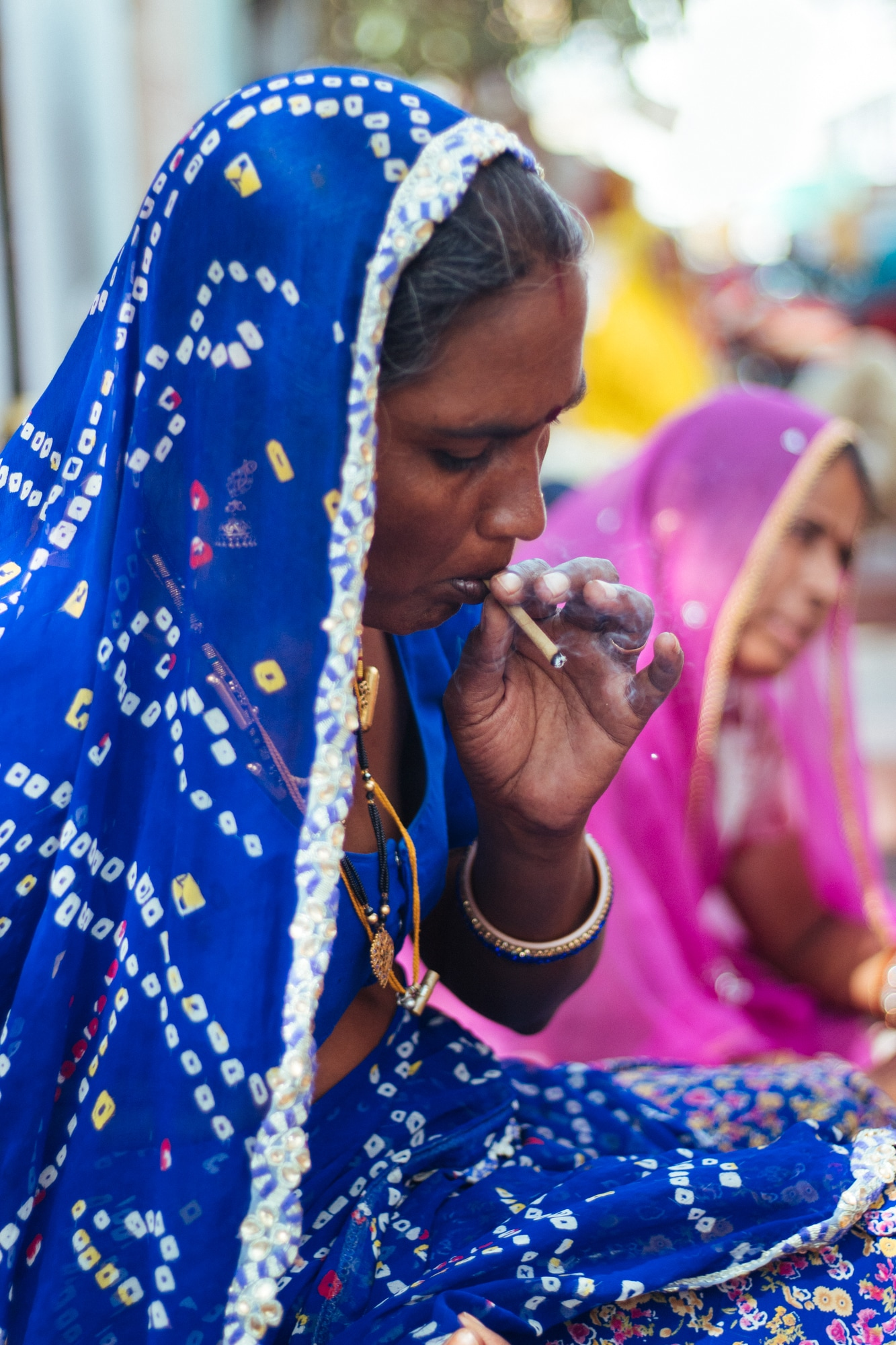 A woman smoking beedi in Pushkar
