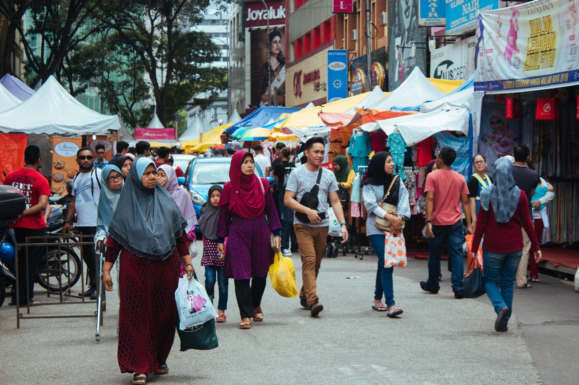 People in Kuala Lumpur shopping for Eid - known as Hari Raya in Malaysia