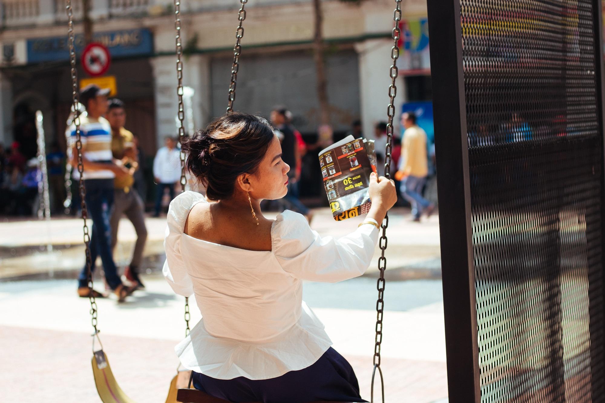 A woman on swing, Kuala Lumpur city center