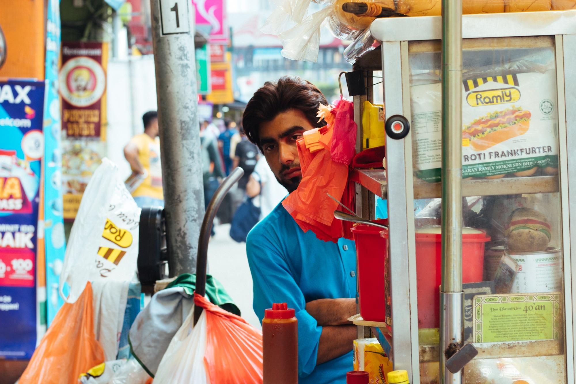 Man at a street food stall, Kuala Lumpur