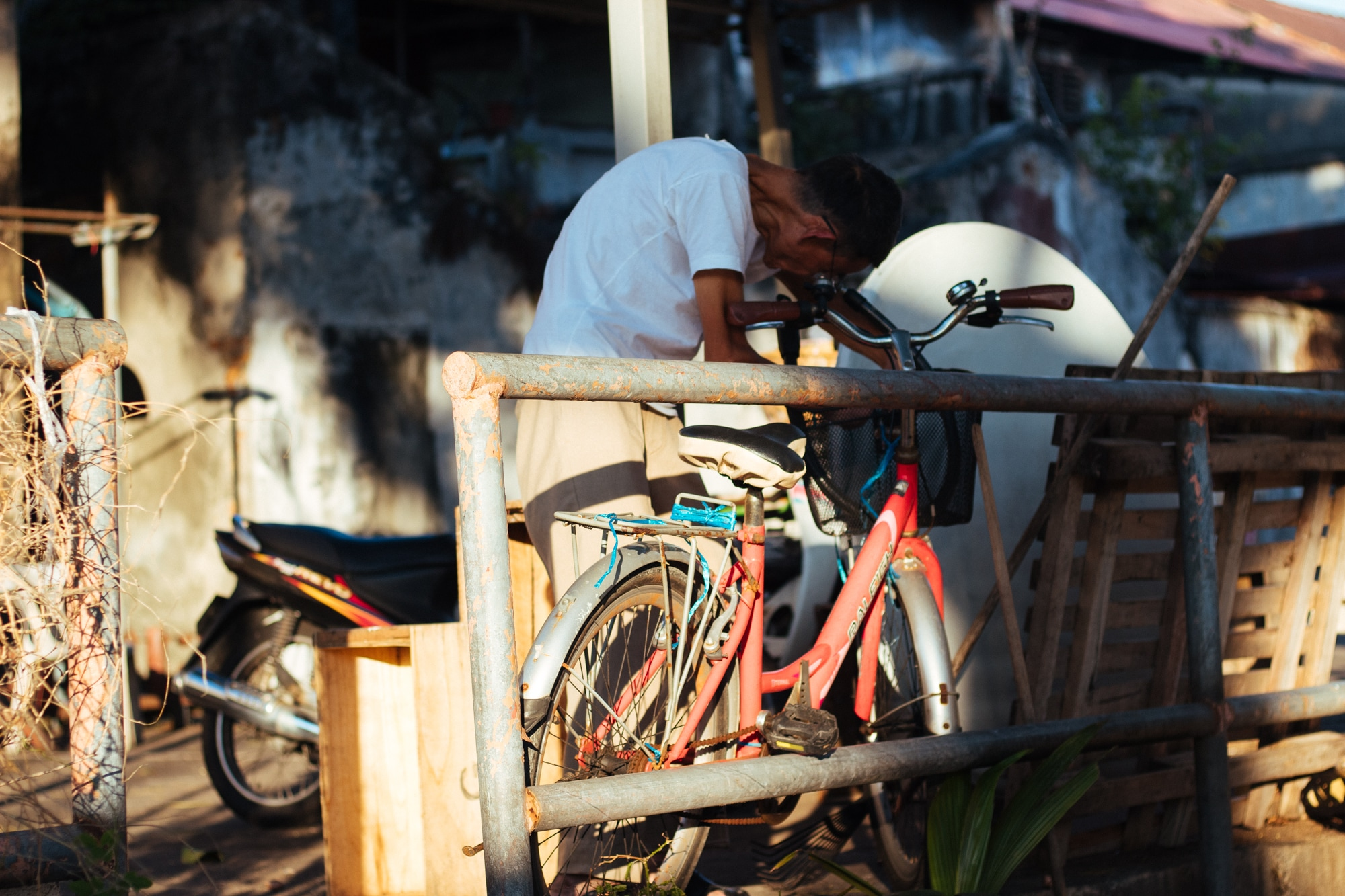 A man busy fixing his bicycle