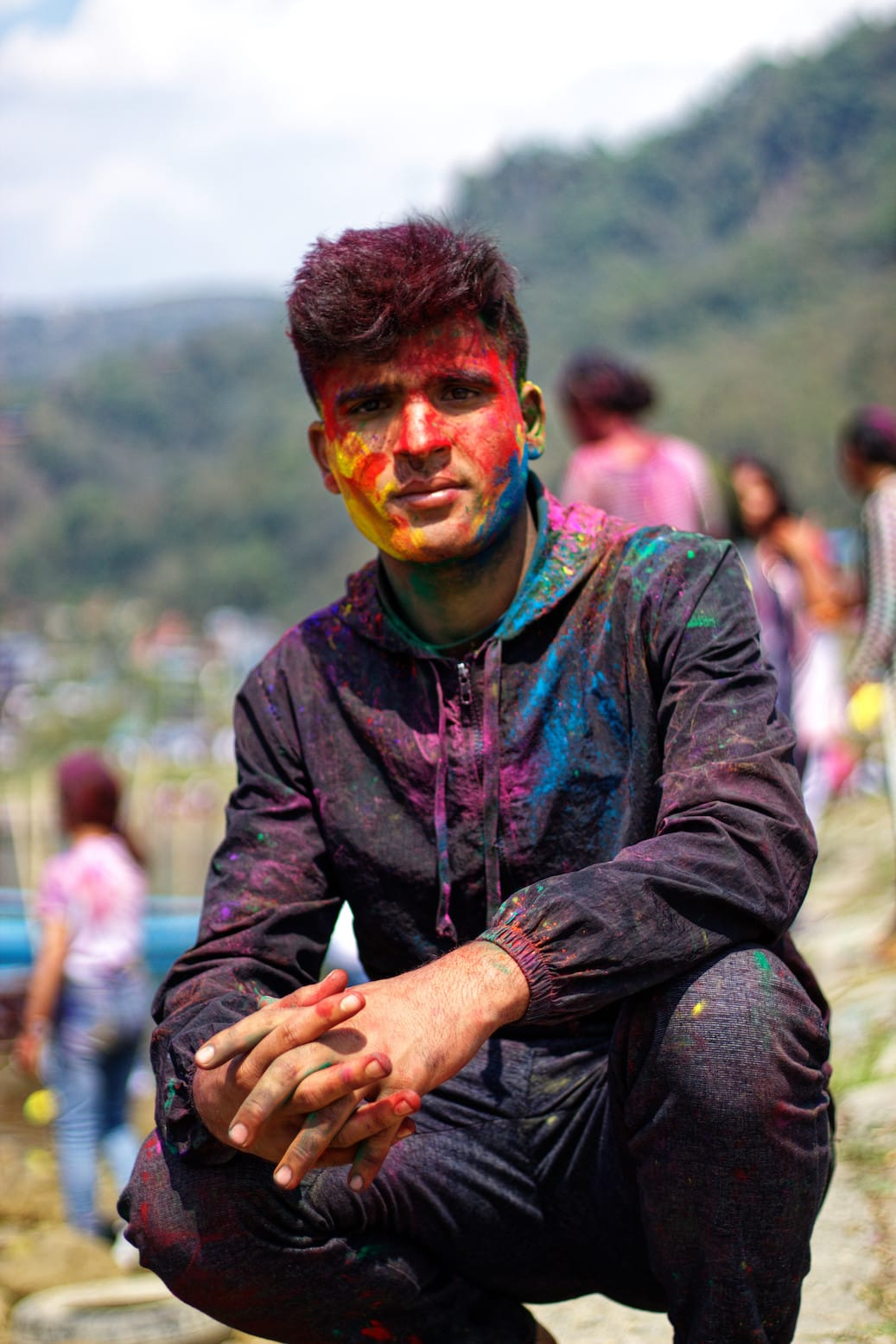 A Boy with Face Covered in Colours