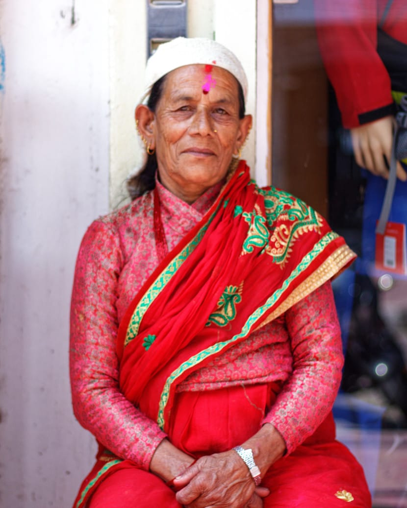 A Woman Dressed in Traditional Clothes