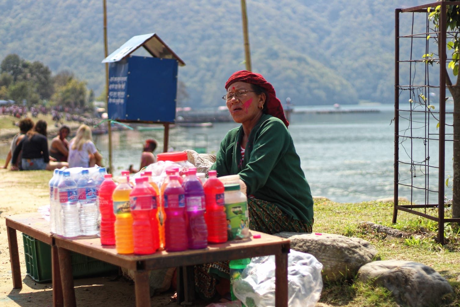A Woman Selling Coloured Water