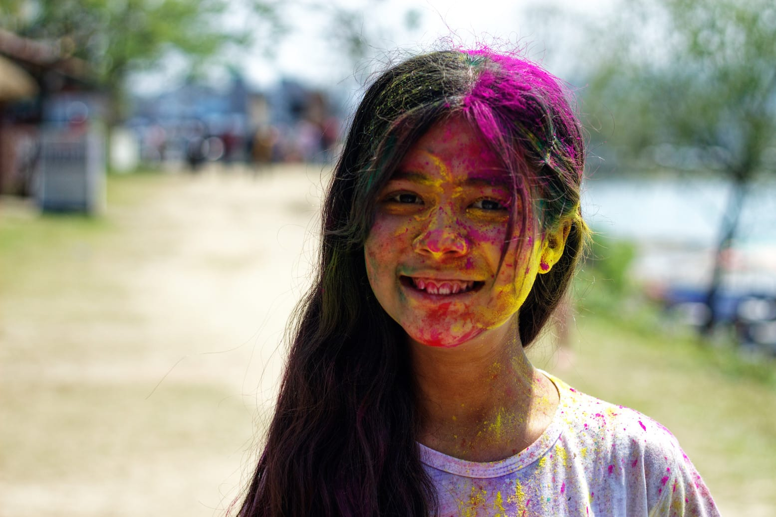 A Young Girl with Colours on Face in Pokhara