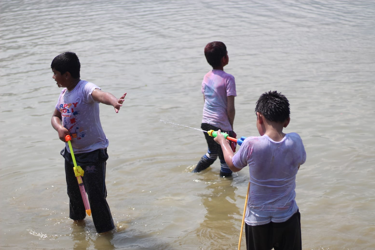 Kids Playing Holi in Phewa Lake