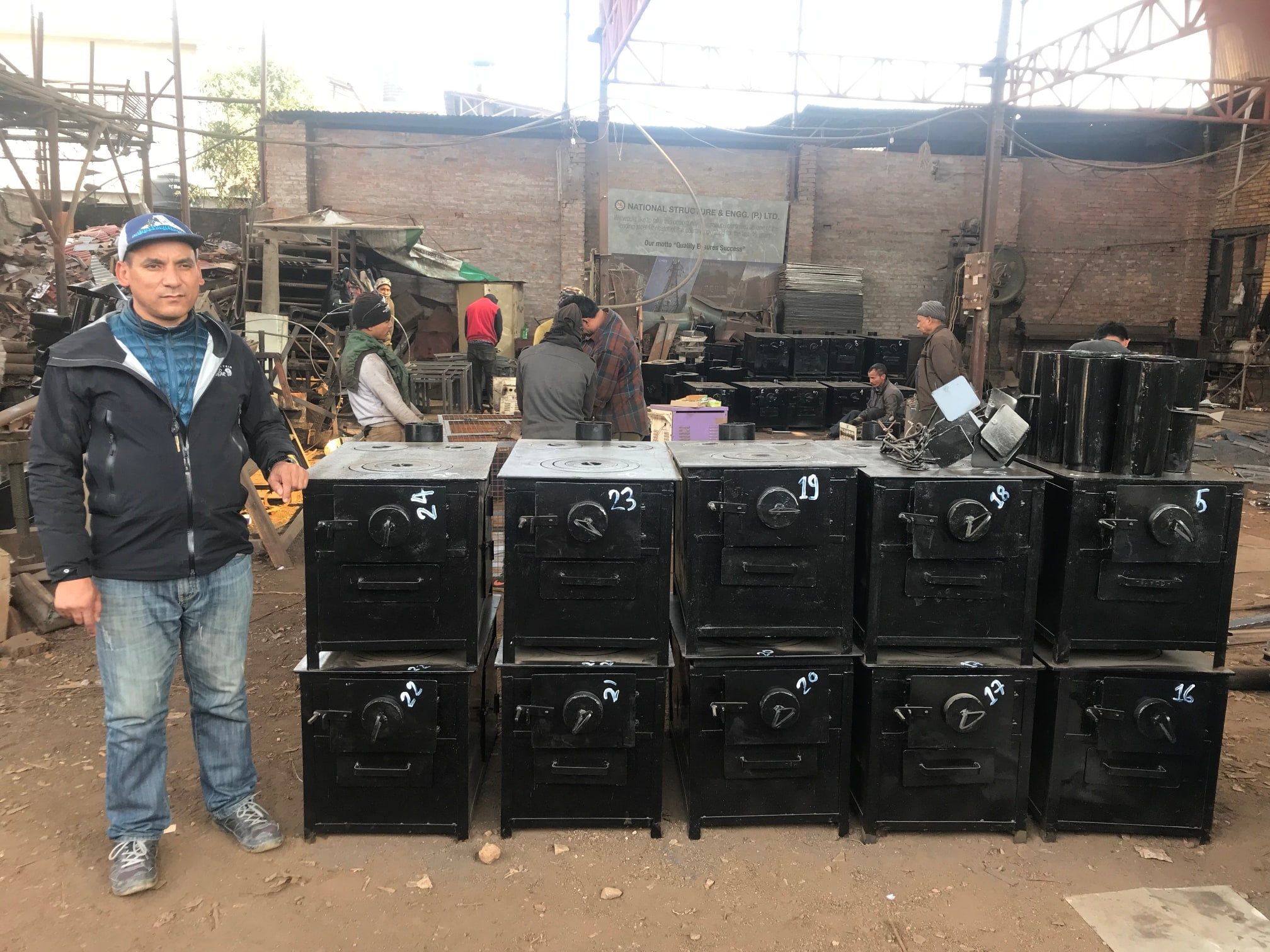 Thile with New Stoves at a Factory