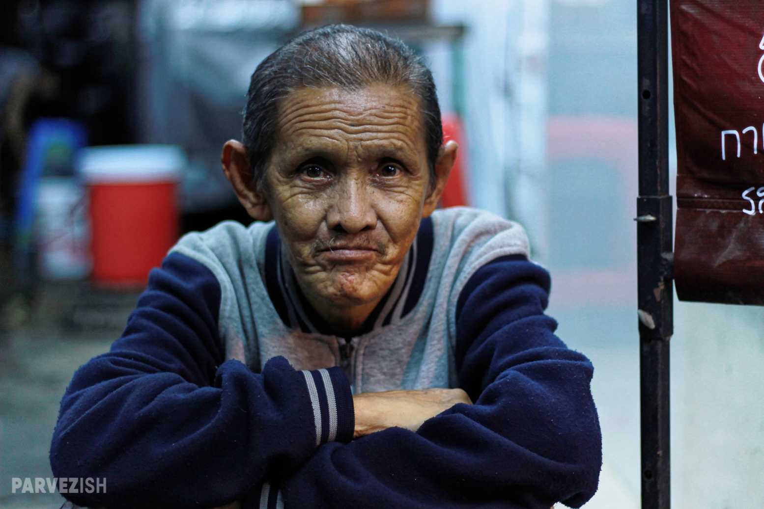 An Aged Man Poses for a Photograph in Streets of Bangkok