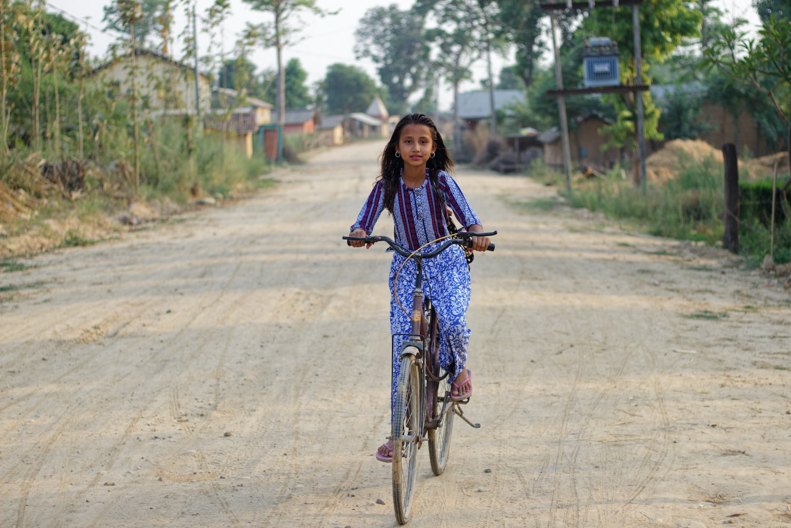 A Young Girl Riding Bicycle in Bardiya Village