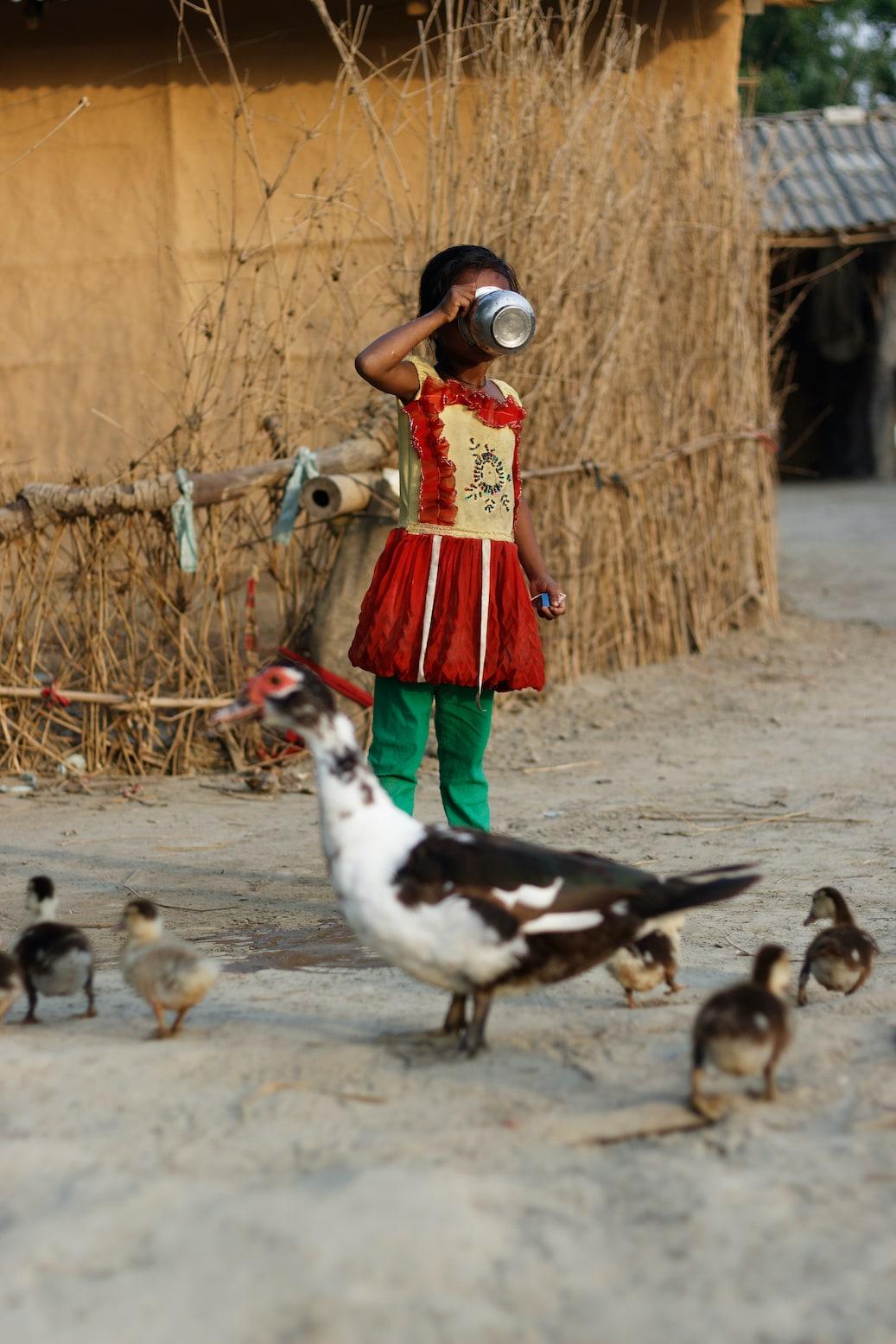 A Girl Outside A Traditional House in Bardiya Village