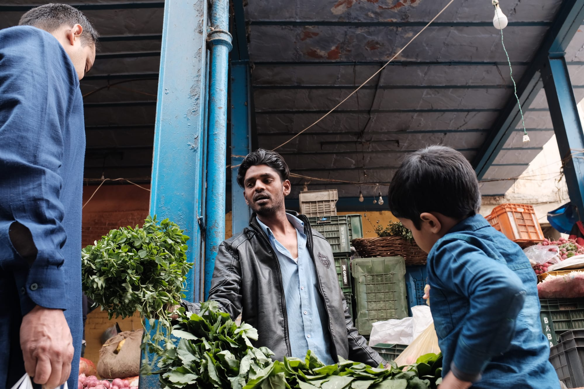 A Man Buying Vegetables with His Son, Delhi, India