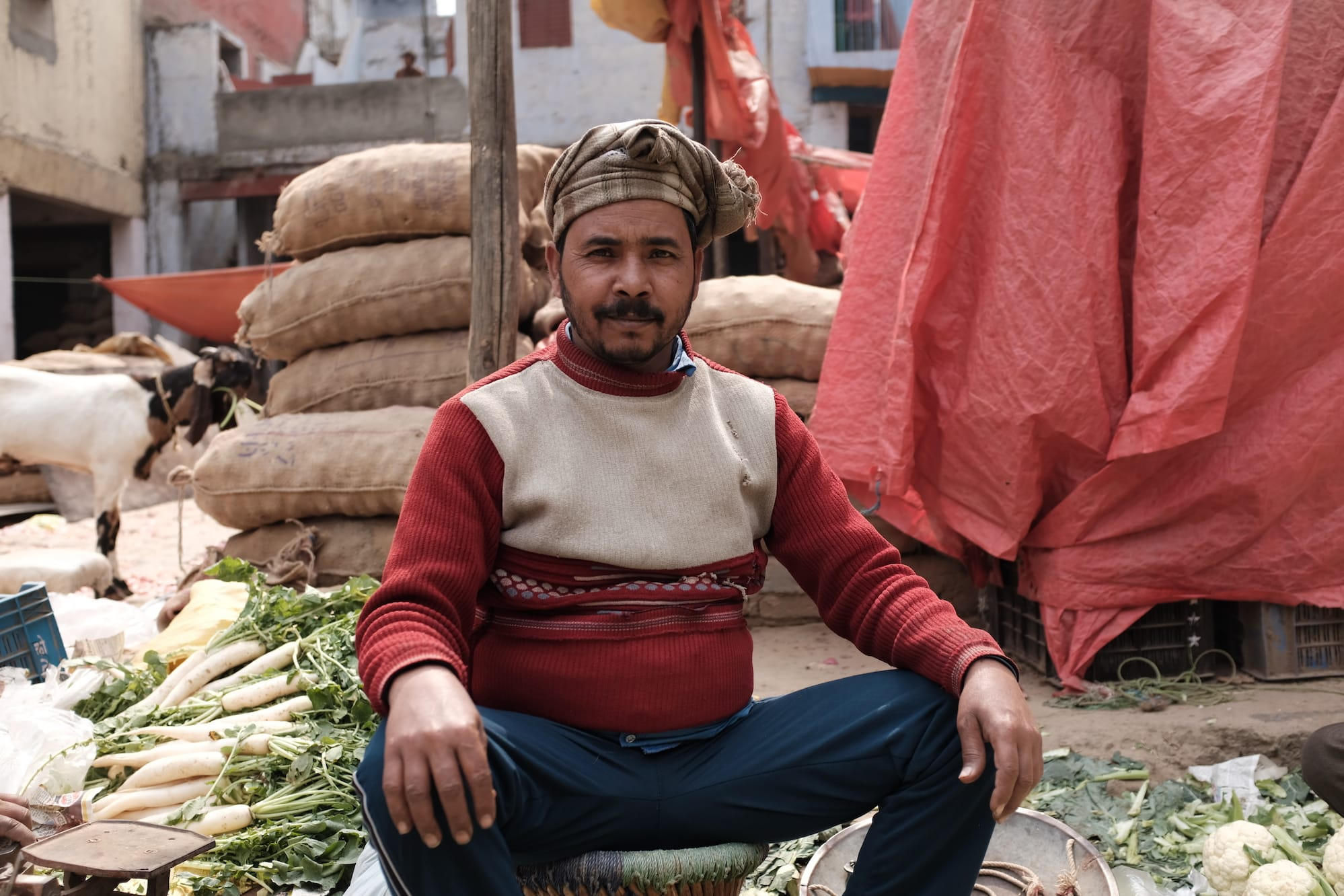 A Vegetable Seller Poses for a Picture in Delhi, India