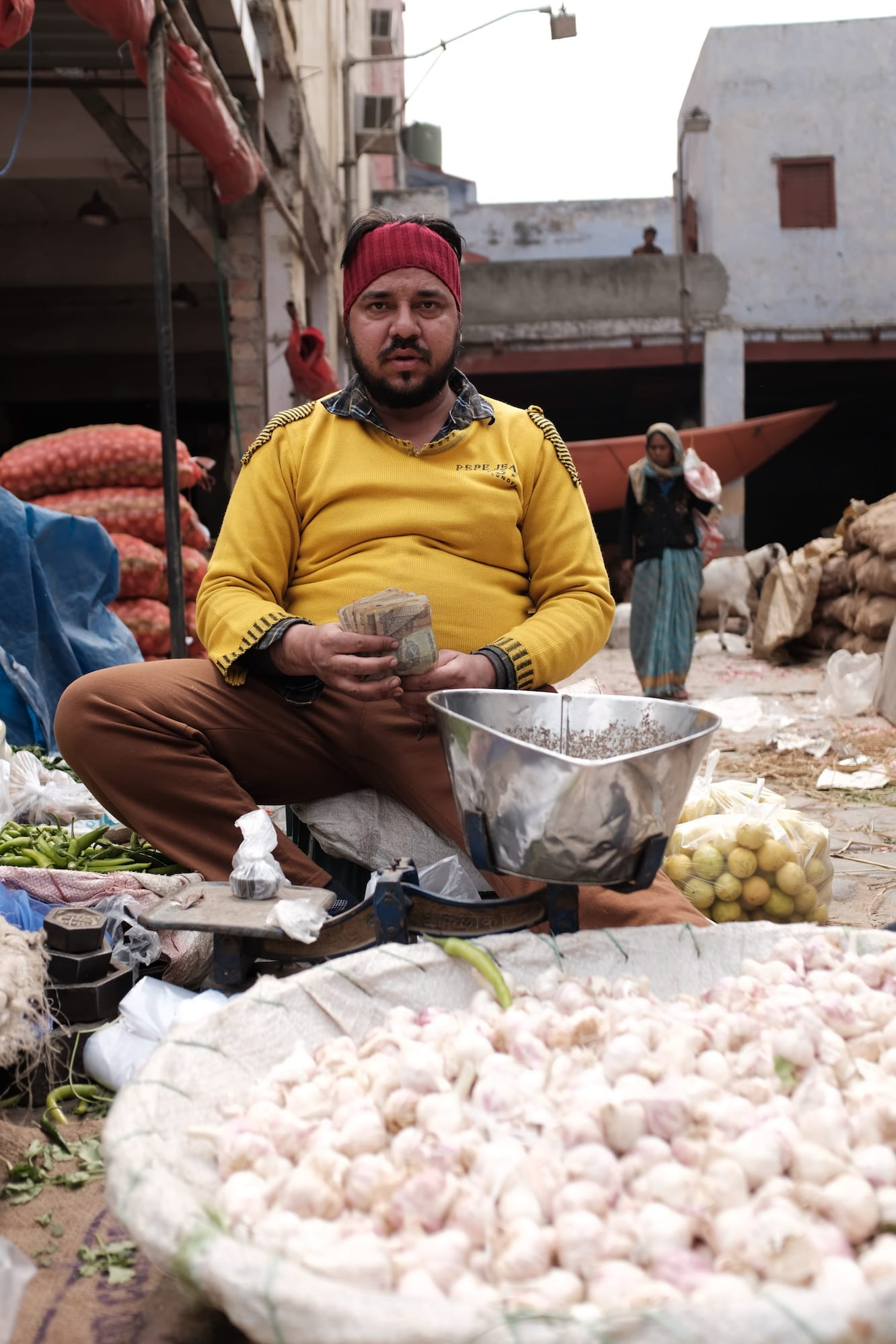 A Vegetable Man Counting Money in Delhi