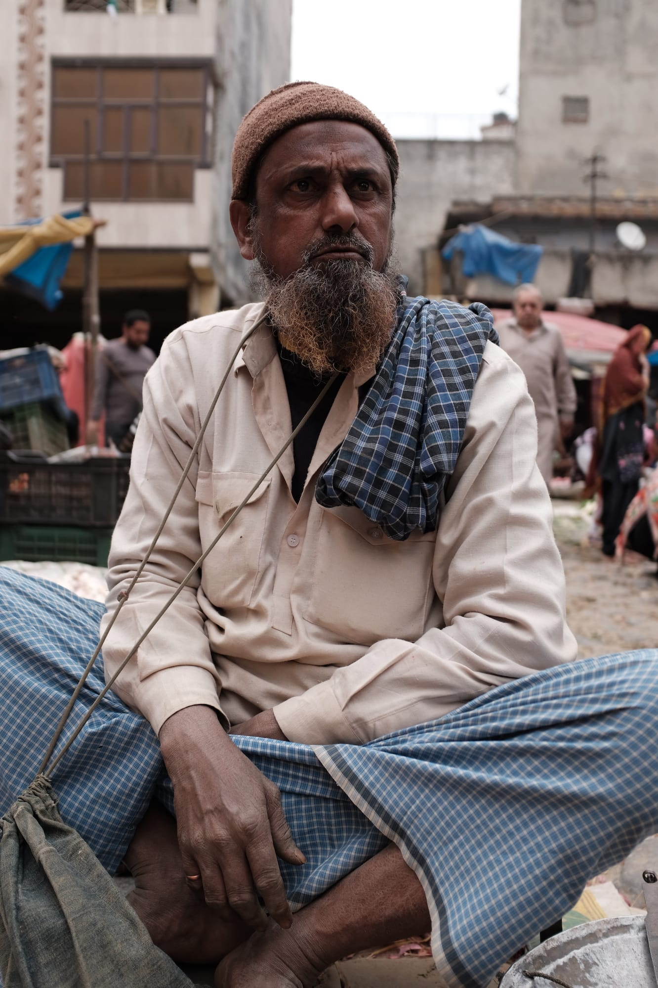 A Man with Beard Selling Vegetables at a Market in Delhi