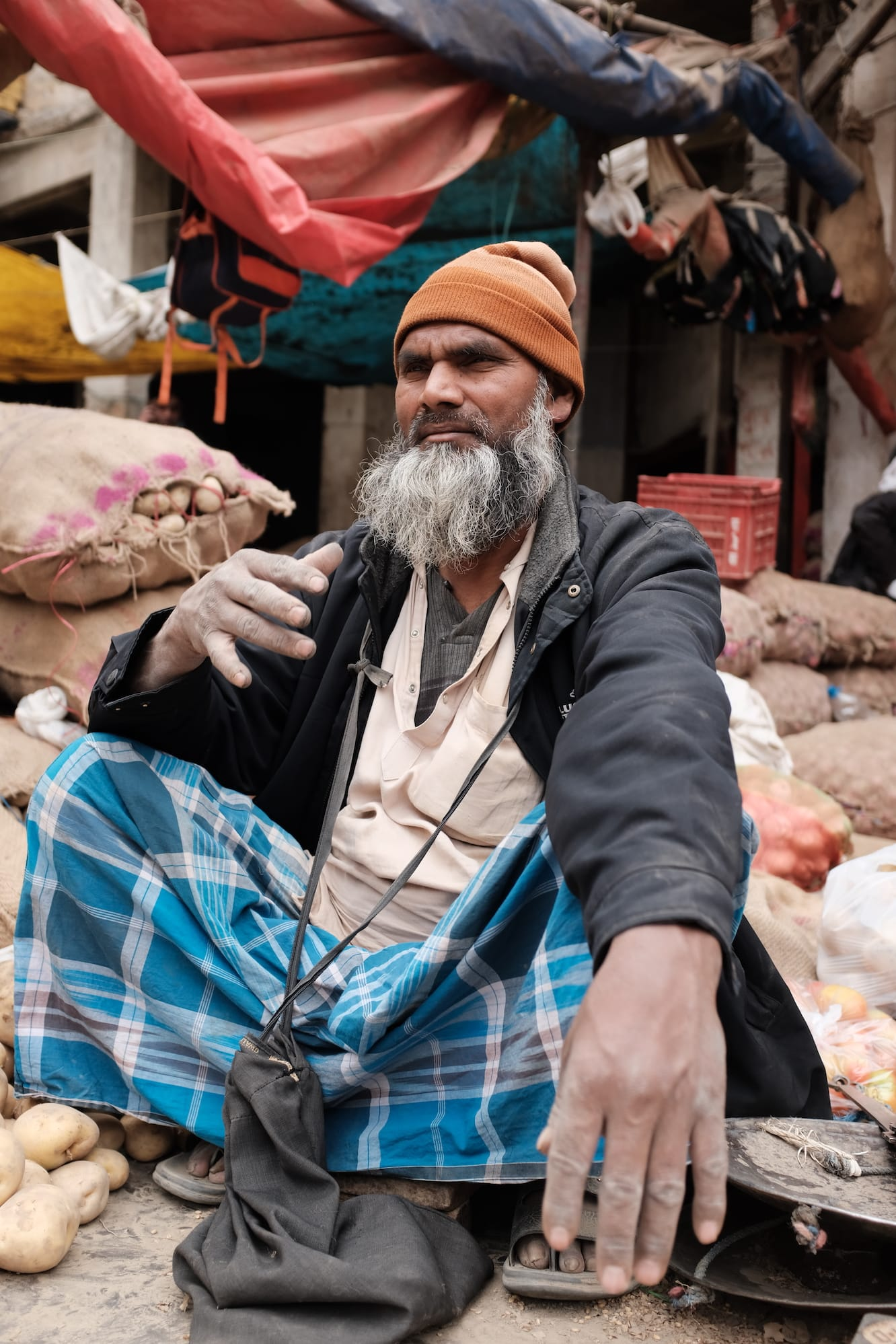 A Vegetable Vendor Posing for a Photo at a Market in Old Delhi