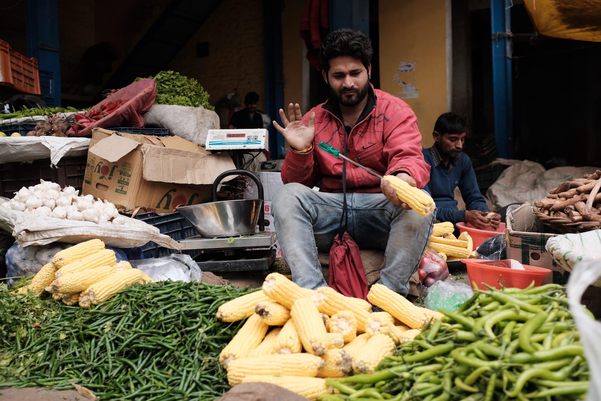 A Man Holding A Corn