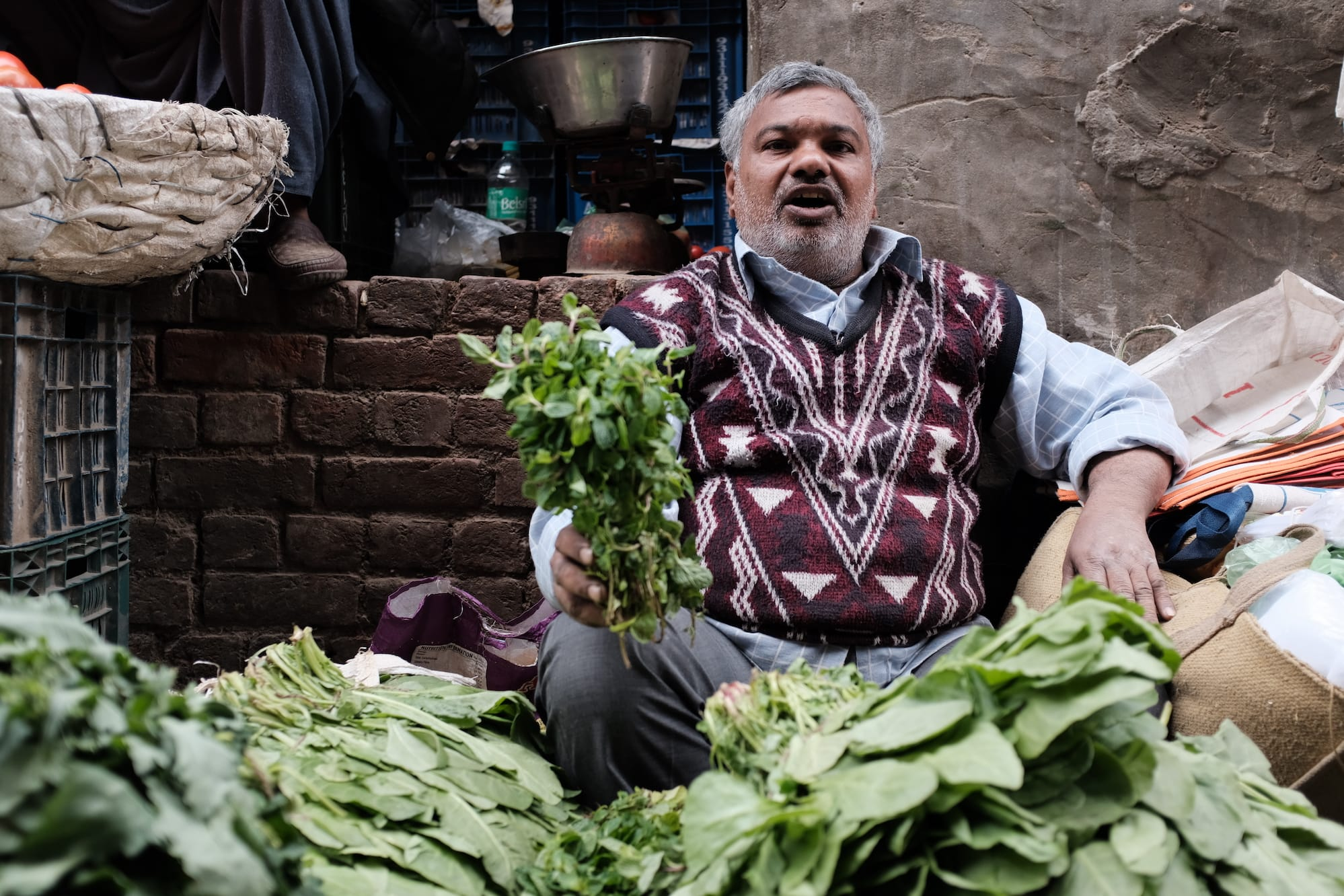 A Vendor at a Vegetable Market in Old Delhi