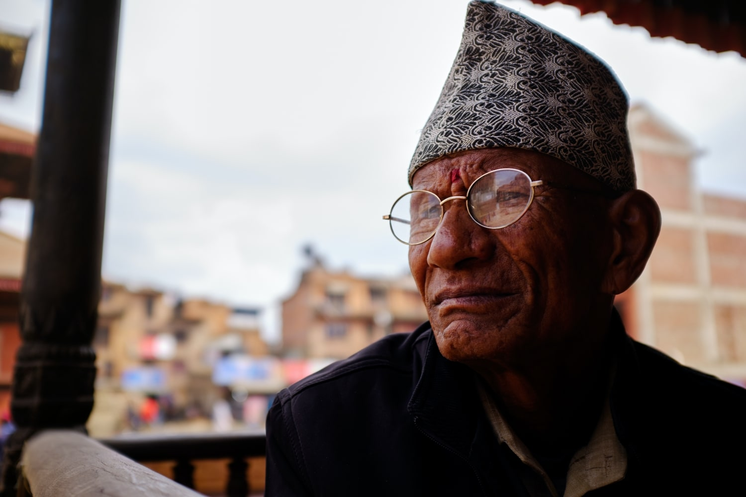 A man in Bhaktapur wearing Dhaka Topi