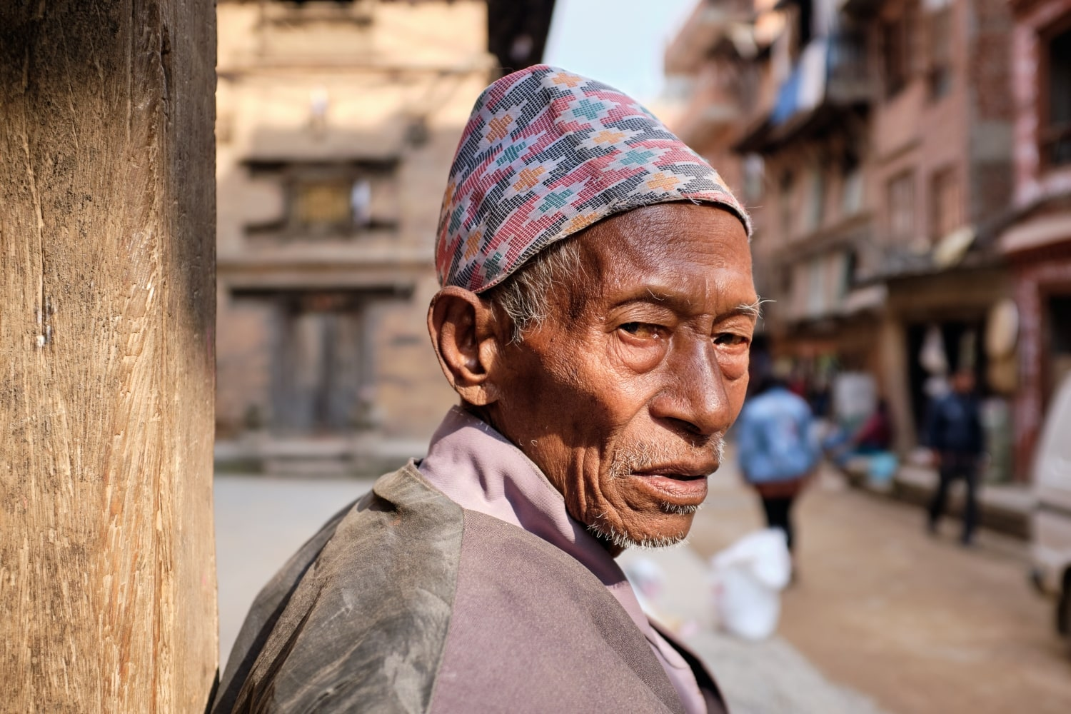 A man wearing Dhaka Topi photographed in Bhaktapur